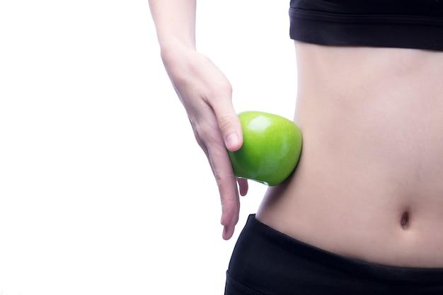 Dobre zdrowe ciało i krzywa talii i zielone jabłko