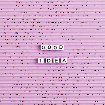 Dobry pomysł typografia list koraliki różowa tapeta