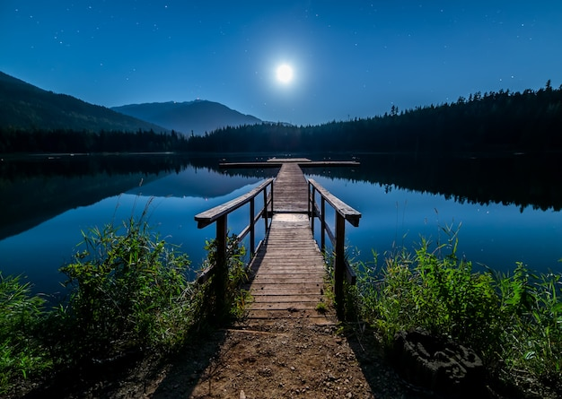 Dock and moon with whistler mountain