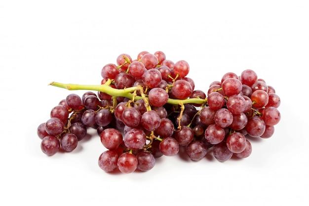 Dojrzały czerwony winogrono na białym tle, świeżość