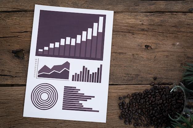 Dokument wykresu wzrostu gospodarczego umieszczony w widoku z góry stołu