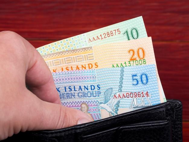 Dolar wysp cooka w czarnym portfelu