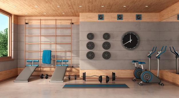 Domowa siłownia w betonowym i drewnianym pokoju