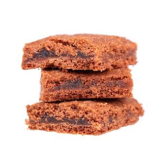 Domowej roboty czekoladowy ciastko deser, odizolowywający na bielu. kromki brownie, ciastka, herbatniki.
