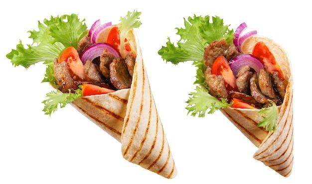 Doner kebab lub shawarma z dodatkami: mięso wołowe, sałata, cebula, pomidory, przyprawa.