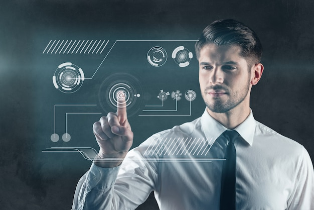 Dotknij przyszłości. cyfrowo wygenerowany obraz mężczyzny naciskającego przycisk na przezroczystej tablicy do wycierania