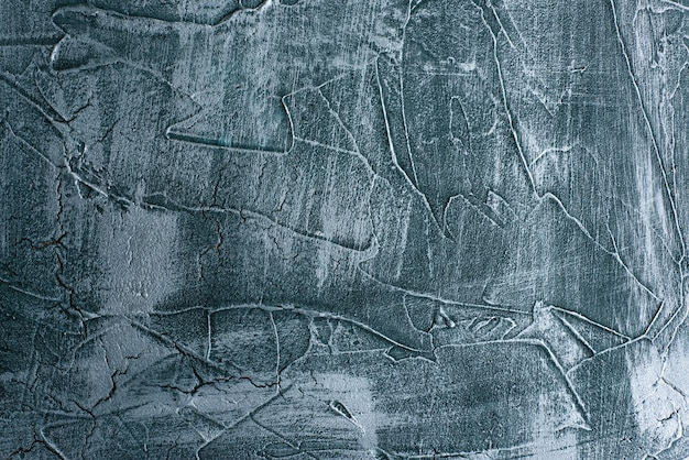 Dramatyczny niebieski nieczysty kamień tekstura tło tynk wenecki wystrój. pęknięty grungy betonowej dekoracji cementowej.