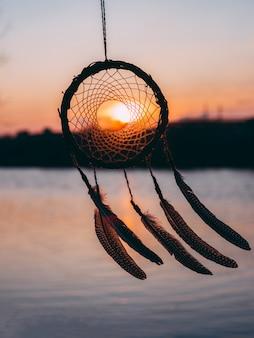 Dreamcatcher zachód słońca etniczny amulet, indyjski symbol
