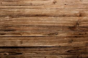 Drewniana deska z teksturą tle materiału