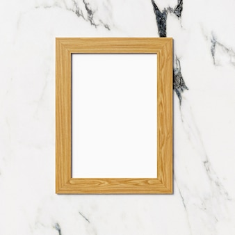 Drewniana fotografii rama na marmurowym tle