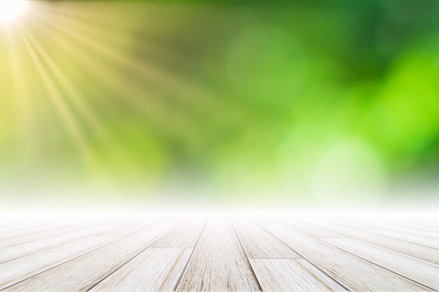 Drewniana podłoga scena tło zielony bokeh ze słońcem