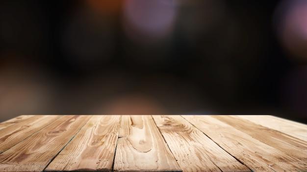 Drewniana powierzchnia na rozmytym czarnym tle