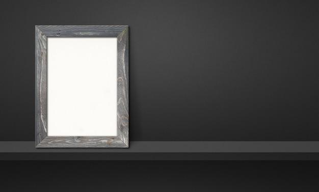 Drewniana ramka na zdjęcia oparta na czarnej półce. ilustracja 3d. pusty szablon makiety. baner poziomy