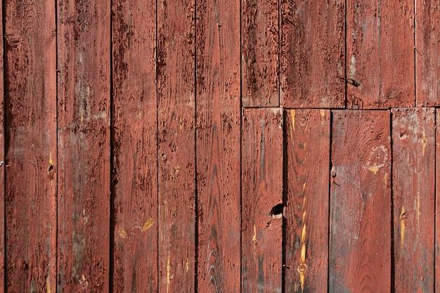 Drewniana tekstura czerwonego koloru tło