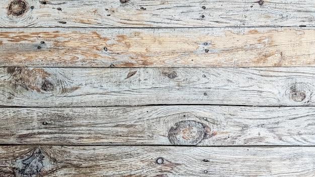 Drewniane deski tekstura tło grunge. zbliżenie szarych drewnianych paneli ogrodzeniowych