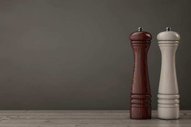 Drewniane młynki perrer lub młynek do soli na drewnianym stole. renderowanie 3d