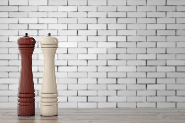 Drewniane młynki perrer lub młynek do soli przed ceglaną ścianą na drewnianym stole. renderowanie 3d