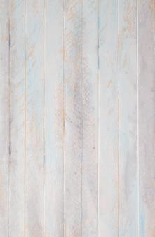 Drewniane pastelowe tło pomalowane na biało i niebiesko