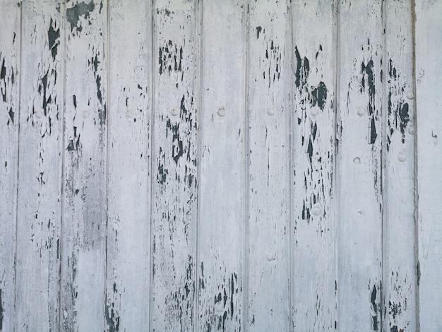 Drewniane tekstury tła powierzchni z pękniętą białą farbą.