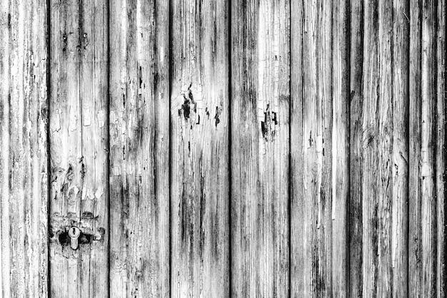 Drewniane tekstury tła w kolorze szarym z zadrapaniami i pęknięciami,