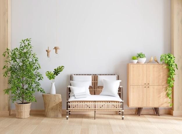 Drewniany fotel i szafka w białym salonie z miejscem na kopię