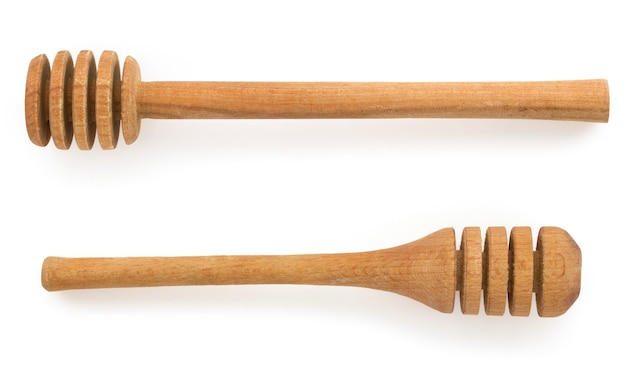 Drewniany kij miodu na białym tle