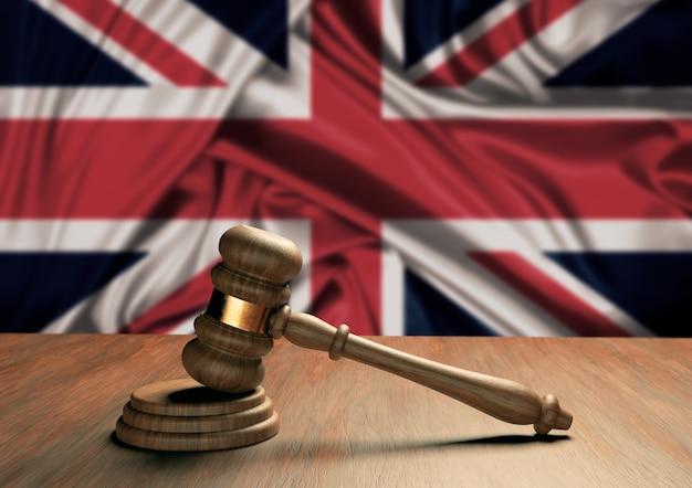 Drewniany młotek sędziowski symbol prawa i sprawiedliwości z flagą anglii. angielski sąd najwyższy. renderowanie 3d