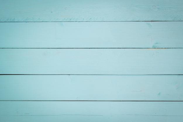 Drewniany obraz z aqua pastelowym kolorem jako tło