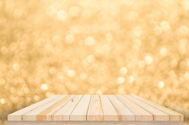 Drewniany stół lub drewniana podłoga z abstrakcyjnym złotym bokeh i tłem fajerwerków do wyświetlania produktów