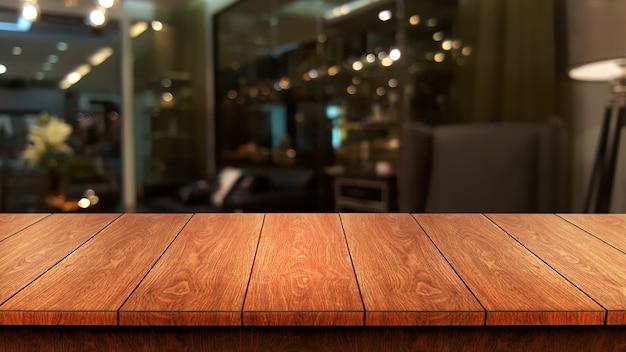 Drewniany stół w rozmytym nowoczesnej sali restauracyjnej lub kawiarni do makiety wyświetlania produktów.