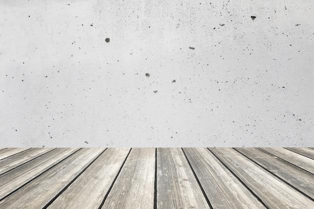 Drewniany stołowy wierzchołek i betonowej ściany tło