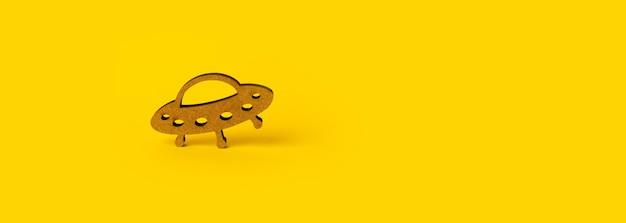 Drewniany symbol ufo na żółtym tle, makieta panoramiczna