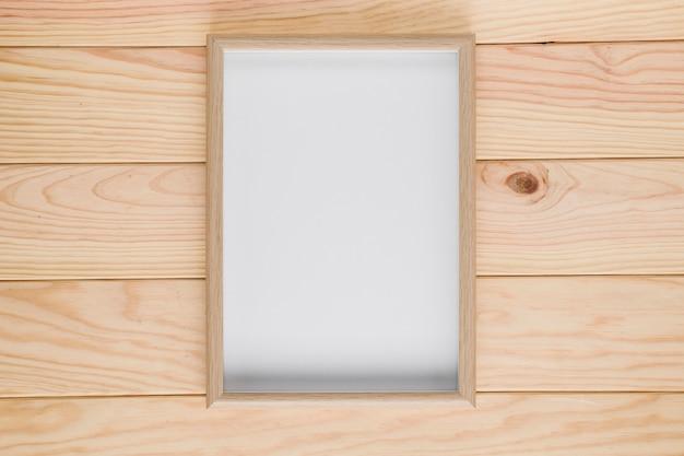 Drewniany tło z pustą ramą