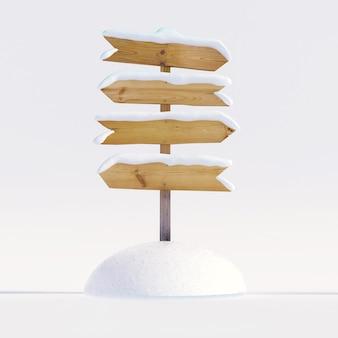 Drewniany znak kierunkowy pokryty śniegiem