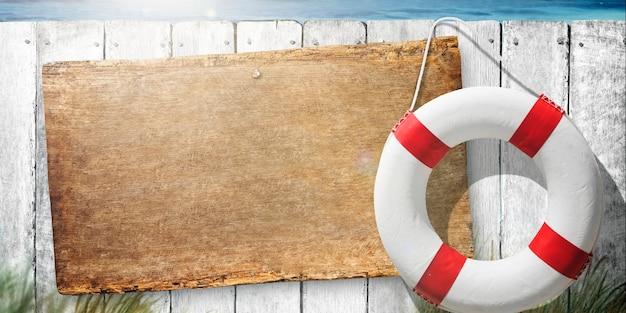 Drewniany znak obok życia pływakowy pierścionek