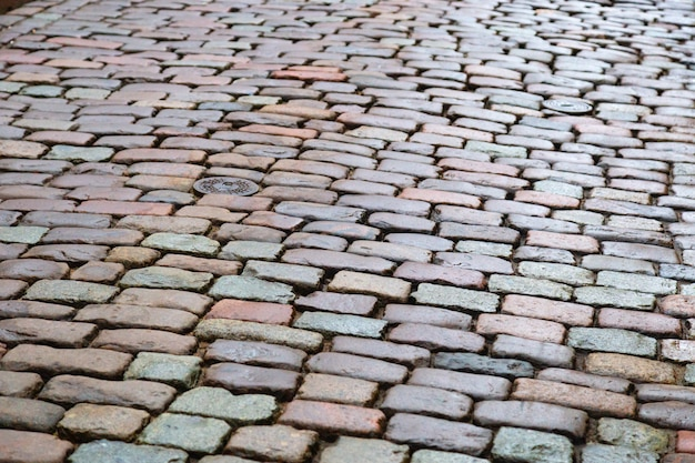 Droga brukowa. tekstura kamienia tło z kamieniami. selektywne ustawianie ostrości.