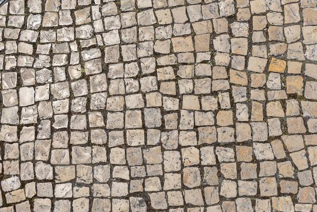 Drogi tła kamienna tekstura, ulicy tekstury dachówkowej odgórny widok