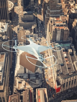 Dron uav leci nad miastem, aby dostarczyć przesyłkę