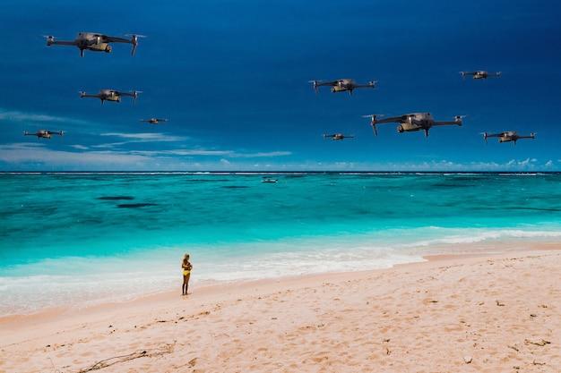 Drony latają nad plażą tropikalnej wyspy na oceanie indyjskim. naturalny krajobraz z przelatującymi nad nim dronami. quadrocopter
