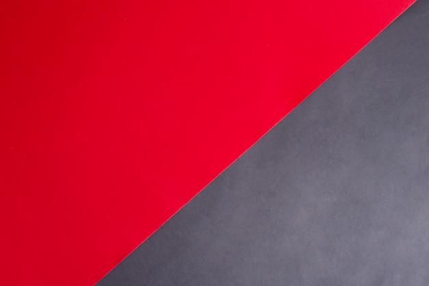 Duotone ukośne tło papercraft dla kreatywności czarno-czerwonych kolorach.