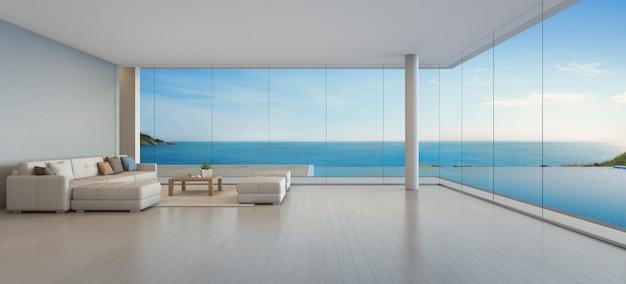 Duża sofa na drewnianej podłodze w pobliżu szklanego okna i basen z tarasem w apartamencie na najwyższym piętrze.