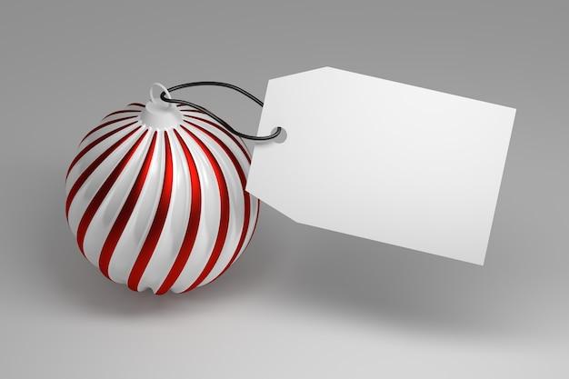 Duża świąteczna zabawka z czerwonymi białymi paskami i dużą pustą metką