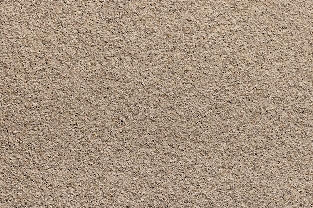 Duży piasek morski jako tło i zbliżenie tapety