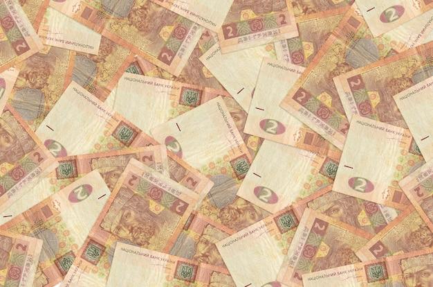 Dwa banknoty w hrywnach ukraińskich leżą na stosie. koncepcyjne tło bogate życie. dużo pieniędzy