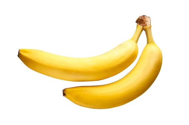 Dwa dojrzałe żółte banany na białym tle. widok z góry.