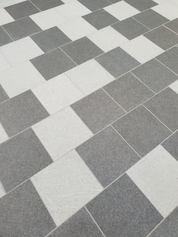 Dwa odcienie szarości płytek podłogowych w losowym wzorze