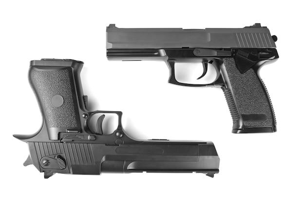 Dwa pistolety. desert eagle i m23 double eagle