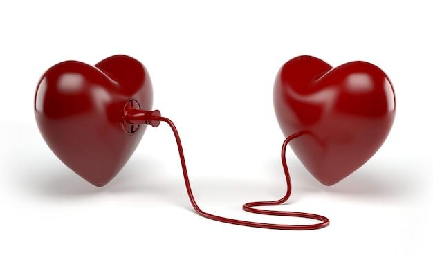 Dwa serca z przewodem elektrycznym z wtyczką dookoła