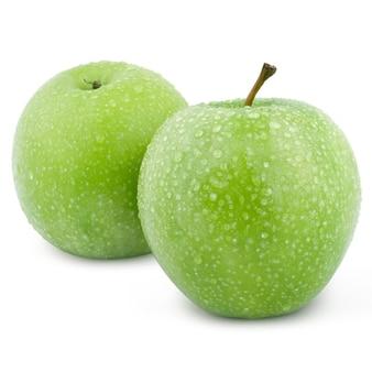 Dwa zielone jabłka pojedynczo na białym