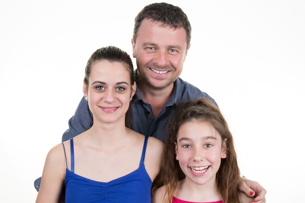 Dwie dziewczyny z ojcem - izolowane nad białą dekoracją chanuki